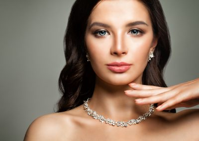 Beautiful Female Face. Young Woman with Perfect Diamond necklace (206)
