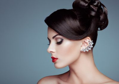 Fashion portrait of young beautiful woman with elegant hairstyle earring (206)