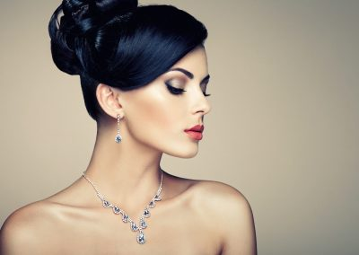 Fashion portrait of young beautiful woman with jewelry earring (206)